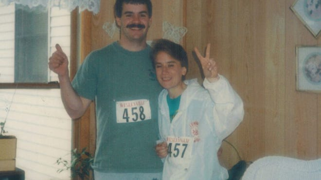 The author, right, with her husband, Dan, left, at one of the first races they participated in (yes, in cotton shorts and tshirts) in the mid-90s.
