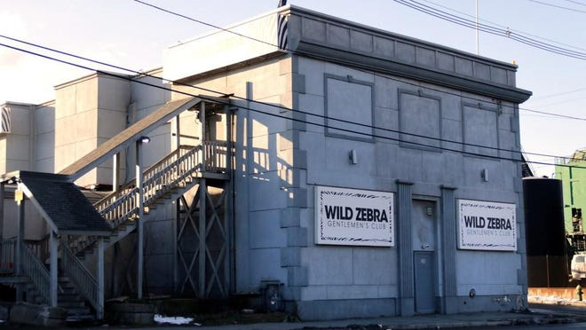 U.S. District Court Chief Judge John J. McConnell Jr. granted the Wild Zebra's request for a preliminary injunction blocking the city from enforcing a Board of License decision to pull the club's licenses.
