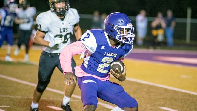 Camdenton sophomore Javari Stewart carries the ball in a game against Lebanon on Friday, October 9, in Camdenton. Stewart and junior teammate Garett Stark were wearing pink amongst their uniforms to show support for breast cancer awareness.