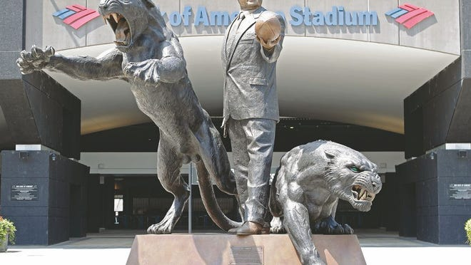 In this July 10, 2018, file photo, a statue of former Carolina Panthers owner Jerry Richardson stands outside an entrance to Bank of America Stadium in Charlotte, N.C.