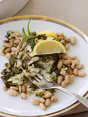 This baked cod in parsley sauce  gains extra fiber and protein from the beans and healthy fats from the sliced almonds to help make the dish truly filling.