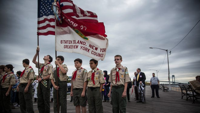 NEW YORK, NY - OCTOBER 29:  Boy Scouts of Troop 37 - Staten Island, prepare to lead a march of Staten Island residents to mark the two year anniversary of Superstorm Sandy's landfall on the region and to call on government leaders to do more to help people who have still not fully recovered from the storm's effects, on October 29, 2014 in the South Beach neighborhood of the Staten Island Borough of New York City.