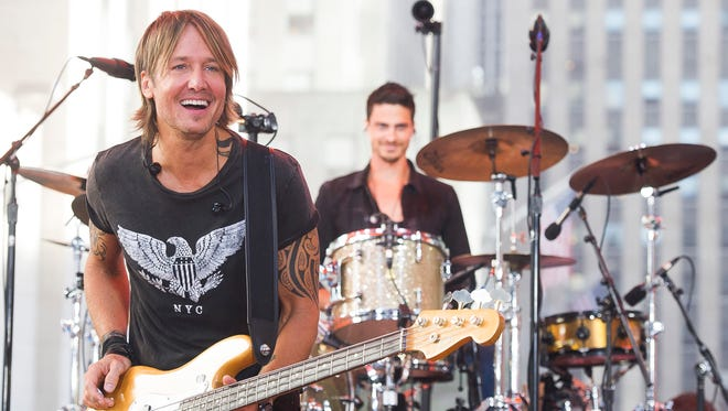 """Keith Urban performs on NBC's """"Today"""" show Friday, Aug. 7, 2015 in New York."""