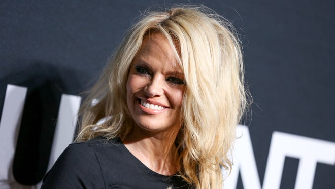 Pamela Anderson arrives at Saint Laurent at the Palladium at the Hollywood Palladium on  Feb. 10 in Los Angeles.