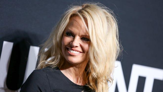 Pamela Anderson arrives at Saint Laurent at the Palladium at the Hollywood Palladium on  Feb. 10 in Los Angeles.