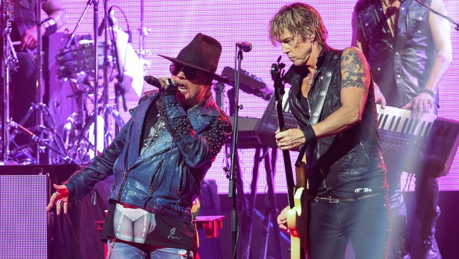 FILE - In this April 23, 2014 file photo, Axl Rose, left, and Duff McKagan of Guns N' Roses perform at the 6th Annual Revolver Golden Gods Award Show in Los Angeles