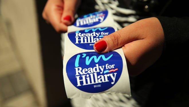 Hillary Clinton stickers are shown.