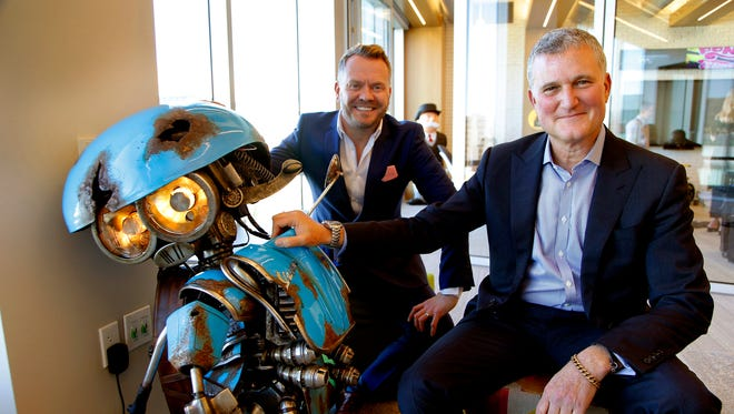 Hasbro executives Simon Waters (Global Brand Licensing) and Steve Davis (Chief Content Officer) pose for a portrait with SQUEAKS (a Vespa scooter), a new Transformer for the up coming Transformer movie on Jan. 25, 2017 in Burbank, Calif.