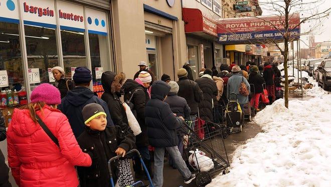 People wait in line for food in Brooklyn on Feb. 18, 2017.