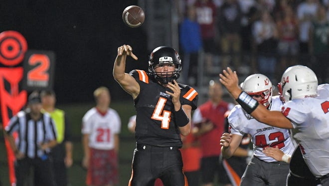 Ripon quarterback Max Huseboe (4) throws a short pass in the backfield. The Ripon Tigers hosted the Columbus Cardinals Friday evening, August 18, 2017, in a nonconference game at Ingalls Field.