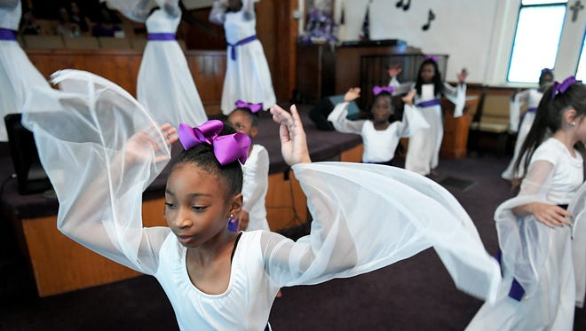 Aubrey Flye and other children dance during a celebration service of First Missionary Baptist Church's 147th anniversary on Sunday, August 20, 2017.