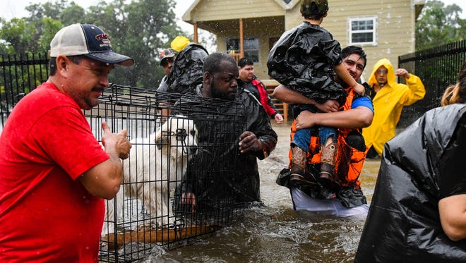 Volunteers and first responders in Lafayette, La., on Aug. 28, 2017.