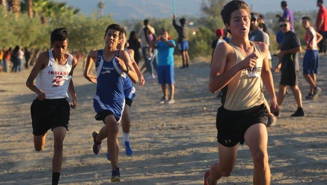 Andres Lopez holds off Edward Arellano, left, and Fabian Acosta at the finish in the second Desert Valley League cross country meet of the season, Wednesday, October 11, 2017.