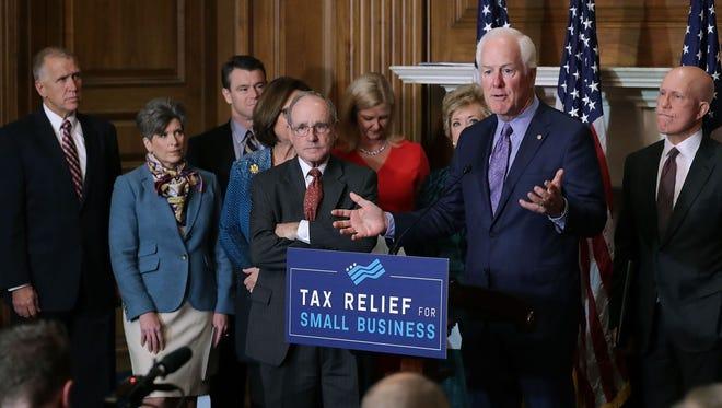 Sen. John Cornyn, R-Texas, and other Republican members of Congress in Washington on Nov. 28, 2017.