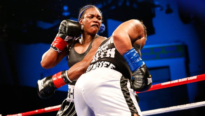 In a photo provided by Showtime, Claressa Shields follows through on a left to Tori Nelson during a boxing bout Friday night, Jan. 12, 2018, in Verona, N.Y. Shields scored a unanimous 10-round decision to retain her women's WBC and IBF super middleweight world titles.