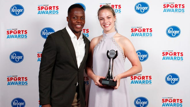 Teddy Bridgewater poses with Kayla Kaiser, accepting the Team of the Year award for Assumption, during the 2018 Courier Journal Sports Awards held at The Louisville Palace in downtown Louisville. June 7, 2018