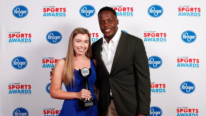 Teddy Bridgewater poses with Kellie Kidder, winner of the Girls Bowler of the Year award, during the 2018 Courier Journal Sports Awards held at The Louisville Palace in downtown Louisville. June 7, 2018