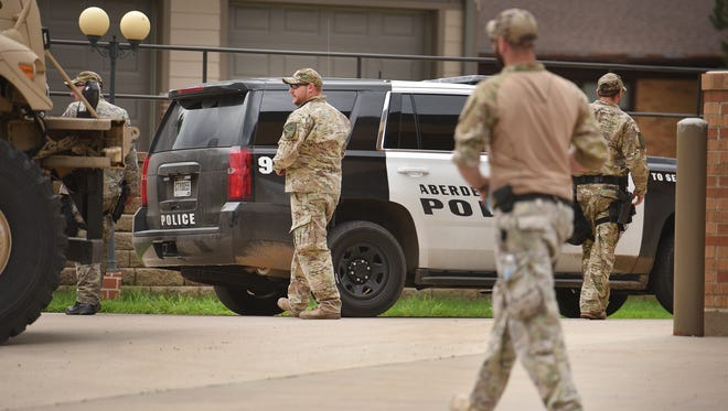 Officials block off the streets around Redfield Community Memorial Hospital Avera Monday, June 25, in Redfield. Matthew James Mathern, 30, was inside the hospital with a 10-year-old before letting the 10-year-old go and surrendering peacfully.