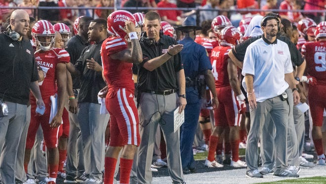 UL coach Billy Napier talks with quarterback Andre Nunez during Saturday night's 49-17 win over Grambling.