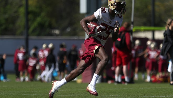 FSU's D.J. Matthews runs with the ball during spring practice at the Al Dunlap Training Facility on Wednesday, March 21, 2018.