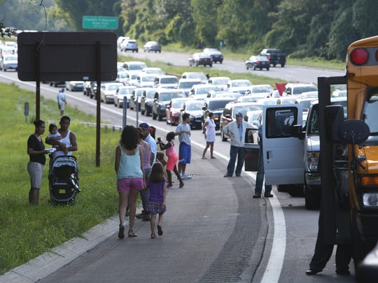 Motorists stuck in traffic at the scene of a fatal accident on the southbound side of the Taconic Parkway in Yorktown on Saturday, Aug. 15, 2015.