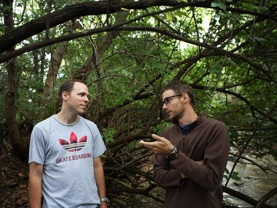 Dan Martin and Jacob Shidler talk about Liquid, a web-based collection system for water sampling, while a group of citizen scientists collect water from Mill Creek for sampling in Evendale. Shidler created Liquid to make it easier for scientists to collect, track and analyze data.