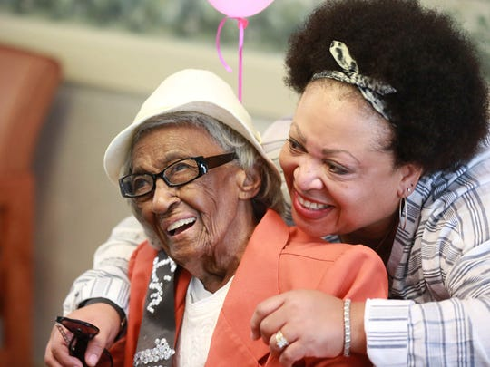 Carrie Lee Braggs (left) celebrates her 106th birthday with family member Diana Davis-Harvey at North Capitol Nursing and Rehabilitation Center.