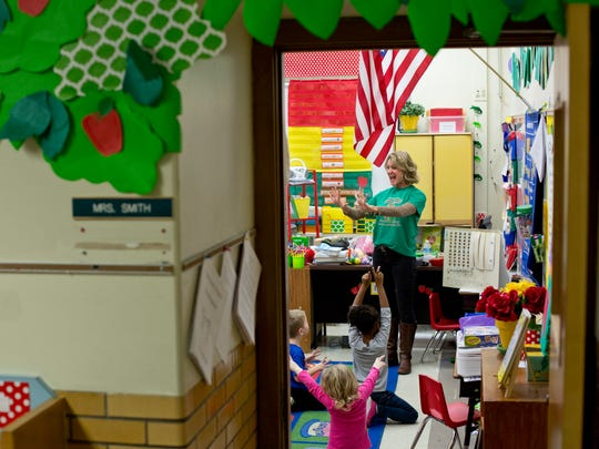 Kindergarten teacher Susie Smith leads her class in