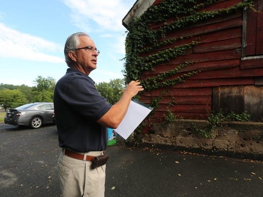 Brian Brooker with Brooker Engineering in Suffern, inspects the Cropsey barn in New City in August.