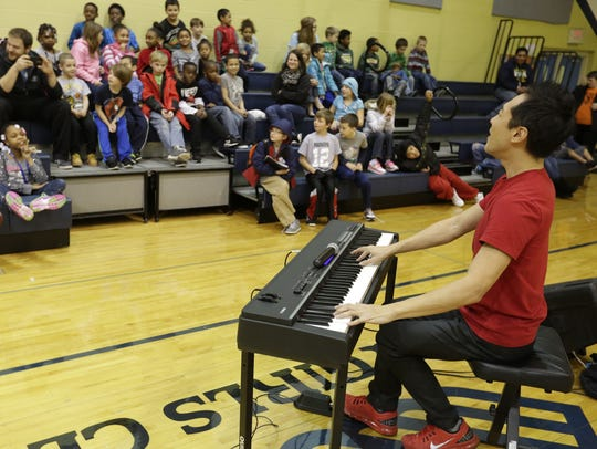 Pianist Alpin Hong entertained students at the Boys