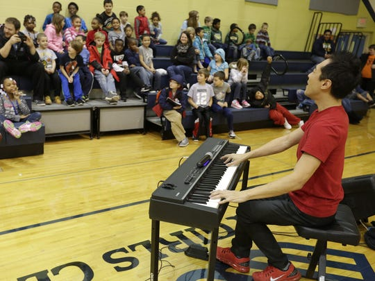 Pianist Alpin Hong entertained students at the Boys and Girls Club of Oshkosh as part of an artist-in-residence program in January 2016.