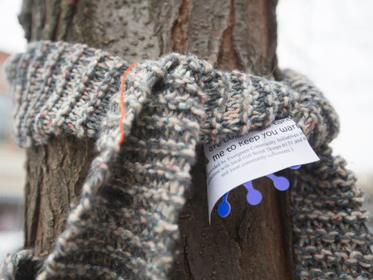 A scarf is tied to a tree in front of the Portage County