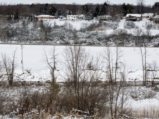 A vacant lot and the Black River near Wadhams and North