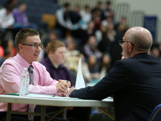 Junior Cole Dunn participates in a mock interview with Mike Jaeger, a manager at Columbia Bank, during Career Day on Friday, Feb. 26, 2016, at Stayton High School. Representatives from a variety of professions, including education, agriculture, banking and construction to name a few, attended the event.