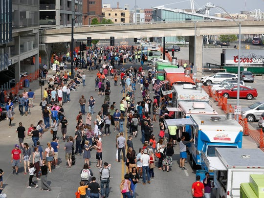 The dinner crowd starts to fill Cherry Street Saturday, May 7, 2016, during the Food Truck Throw Down at the Des Moines Social Club in downtown Des Moines.