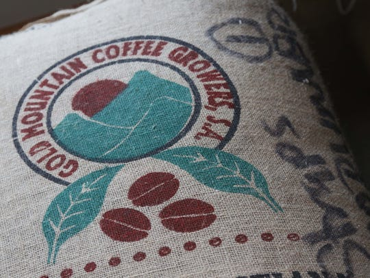 Bags of green coffee are stored in Brian Gumm's coffee