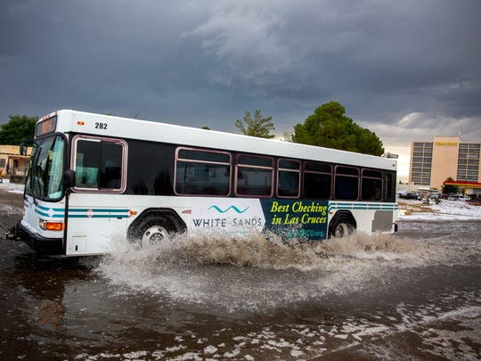 A bus travels through a flooded S. Main St. after a hail storm, May 18, 2016.