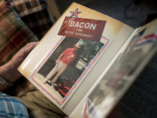 Frank Bacon flips through a scrap book with photographs of his time as a St. Clair County Commissioner Thursday, May 26, 2016 at his Port Huron home. Bacon has been an advocate for others' post-employment benefits since retiring as St. Clair County probate court administrator.