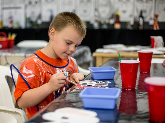 Gabe Lomasney, 6, of Algonac, paints during Hands on