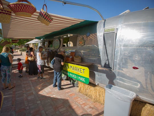 An Airstream trailer converted to a food truck serves