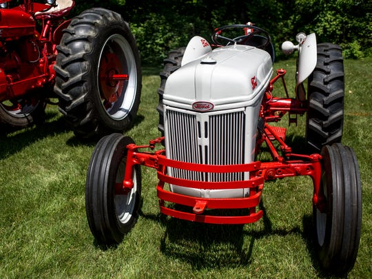 A Ford tractor is displayed during an antique tractor show Saturday, June 18, 2016 in Lexington.