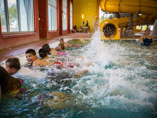 Whether playing at a city pool or swimming at Elephant Butte Lake, experts recommend taking a number of precautions to make sure your family stays safe around the water. Jesse Estrada, left, smiles while he practices swimming with other children at the Las Cruces Aquatic Center in this June 2016 file photo.