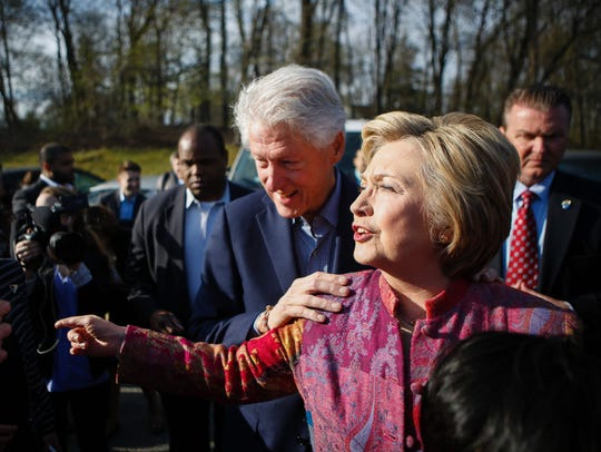 Hillary Clinton, right, with her husband, former President