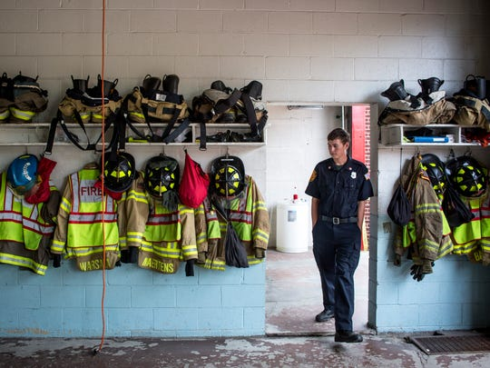 Firefighter Cody Kata walks through a doorway in an engine bay after a groundbreaking ceremony for the new Kimball Township fire station Thursday, July 28, 2016 at Station 1 on Allen Road in Kimball Township.
