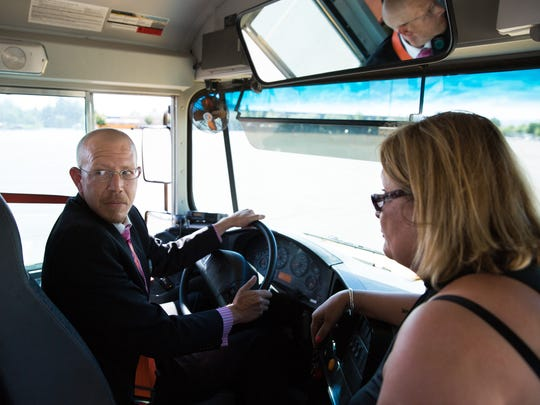 Las Cruces Sun-News Reporter Damien Willis is instructed on how to drive a school bus by SBDI Instructor Maria Caro as he looks back at rowdy passengers simulated by a few Las Cruces public school bus drivers, August 11, 2016, during the first annual School Bus Driver Job Fair hosted by Las Cruces Public Schools and STS of NM.