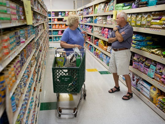 Customer Juanita Gittings, of Port Huron, talks with owner Steve Britz Tuesday, August 16, 2016 at Pet Supplies Plus in Fort Gratiot. The store will be closing in September.
