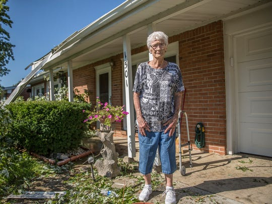 Bettie Johnson, 88, stands in front of her home in the Cedar Crest neighborhood the morning following multiple tornadoes that devastated her area.