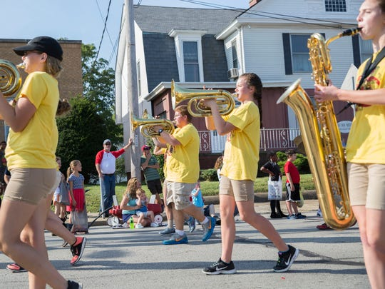 The horn section of a high school band play pass spectators during the Labor Day parade in Boonville on Monday morning.