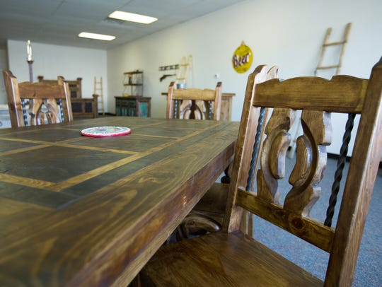 A dinner table with matching chairs available at Rustic