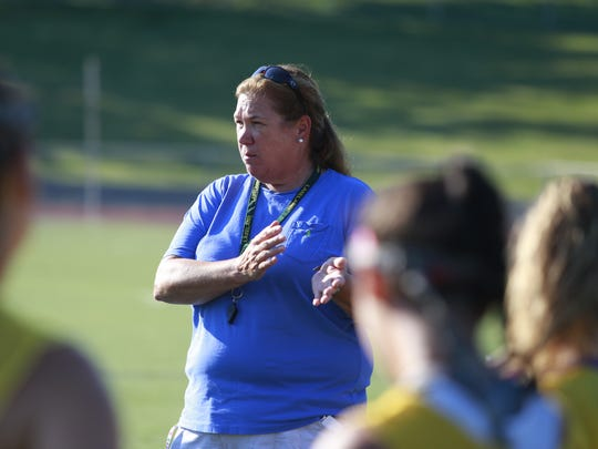 Coach Sharon Sarsen talks to her team at the Lakeland field hockey team at practice at the school in Shrub Oak on Aug. 24, 2016.